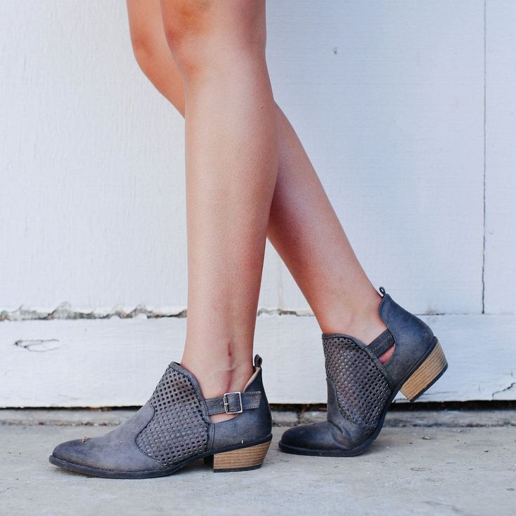 We LOVE this pair of grey ankle booties! All of the little details make this boot have the feeling of a much more expensive version. These crop boots feature cutout sides, a buckled ankle, a block hee