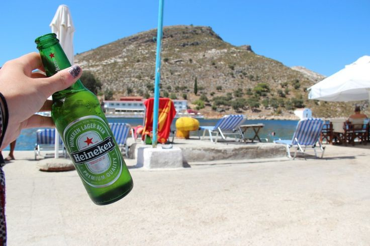 Beers in Paradise.  Read about my day on the colourful Greek island of Meis/ Kastellorizo at http://gallivantgirl.com