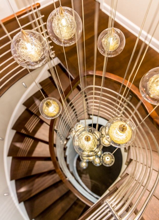 Kadur two story staircase feature shakuff custom staircase chandelier bubble glass dramatic lightingmodern