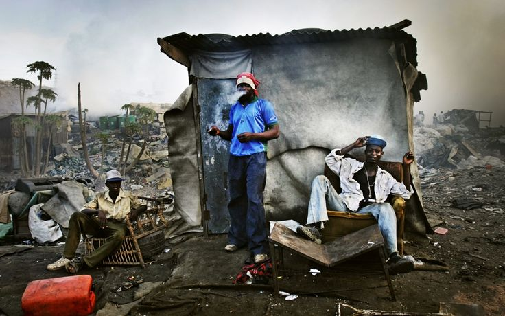 City limits: scavengers on a landfill site in Lagos. Teju Cole charts the underside of Nigeria's growth. Photo: Jacob Silberberg/Panos