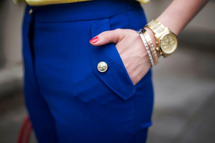 Summer look, detail, blue trousers, gold watch Michael Kors, bracelets