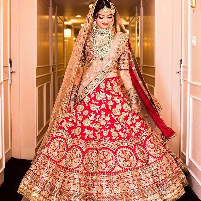 Bride Ramsha captured in a red manish malhotra lehenga. Photo Courtesy- @plushaffairs  #bridalportraits #redlehenga #manishmalhotra #manishmalhotralehenga #twirl #dreamy #lehenga #weddinglehenga #lehengagoals #bridallehenga #pheralook #wedding #bridallook #indianwedding #palacewedding #weddingsutra #traditional #bridalshoot #bridalmakeup #bridalhairstyle #desibride #designerlehenga #indianbride #bridalfashion #instafashion