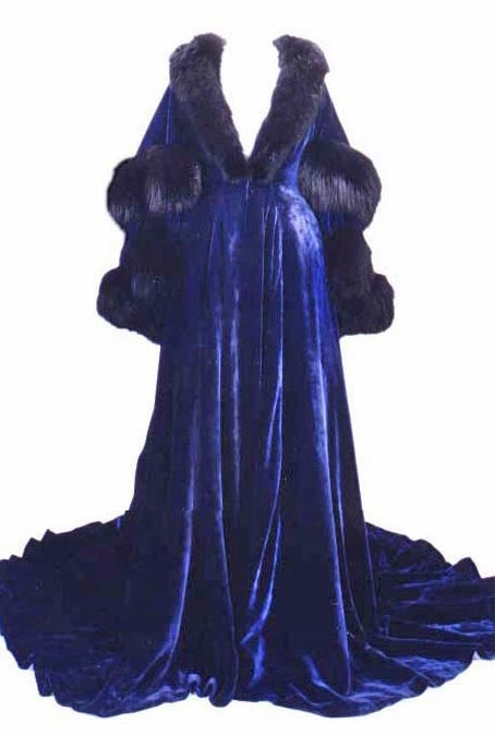 GWTW, 1939: Scarlett O'Hara's blue wrapper, worn while sitting on the patio when she witnessed Bonnie's fatal fall.  The dress required 30 yards of French silk velvet trimmed with fur and took many months to complete. Designers: Carrie Harrell and Jan Hevenor. David O. Selznick Archive.