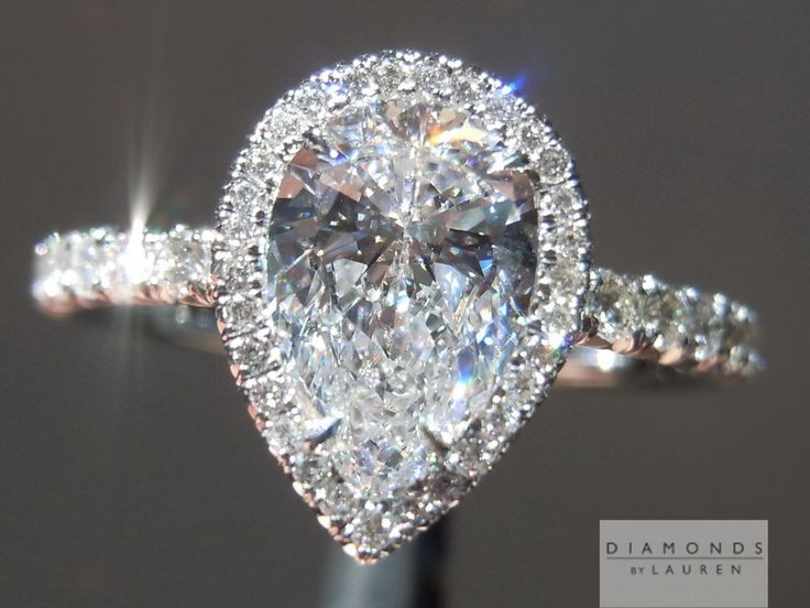 Love! pear shape diamond ring .91 ct center $7495