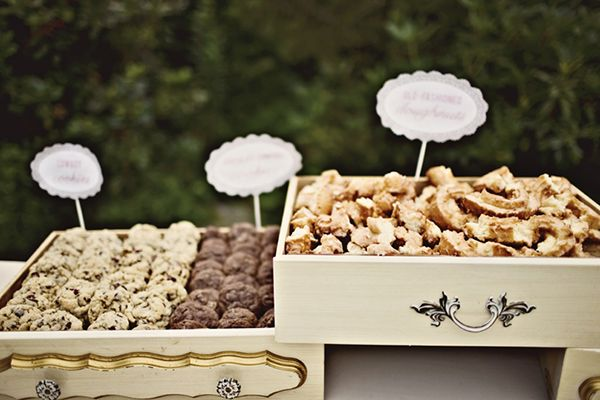 candy favors and sweets display in vintage drawers, cookies, old fashioned glazed doughnuts