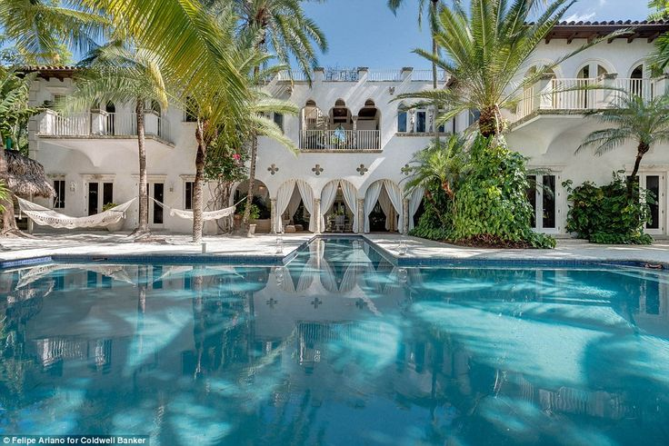 The Miami Beach, Florida home once owned by rock star Lenny Kravitz is up for sale at $25million. Above, a view of the home's saltwater swimming pool