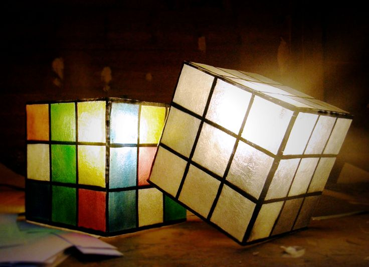 Available in two colors: Color Rubik's and B&W Rubik's.We use only 25W bulbs in our photos, so that their colors can be clearly recognisable.  For more pics, pleace cut and paste the following links:  Color Rubik's Cube -> http://gshopspot.gr/product.php?product_id=615 B&W Rubik's Cube -> http://gshopspot.gr/product.php?product_id=616