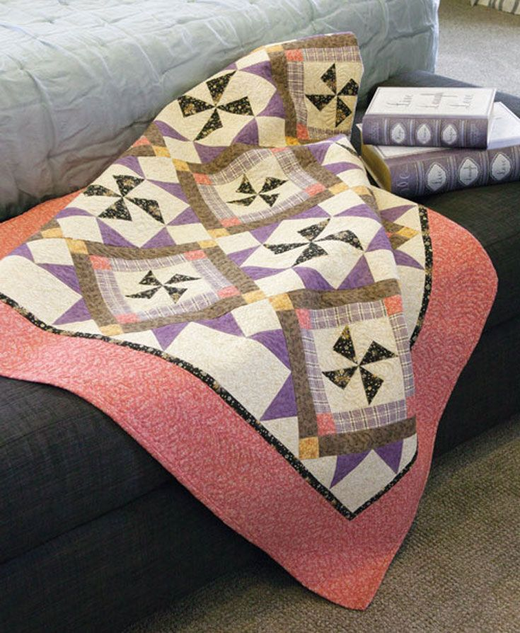 Two quilt blocks and pieced setting sections work beautifully together in this fall-themed quilt.
