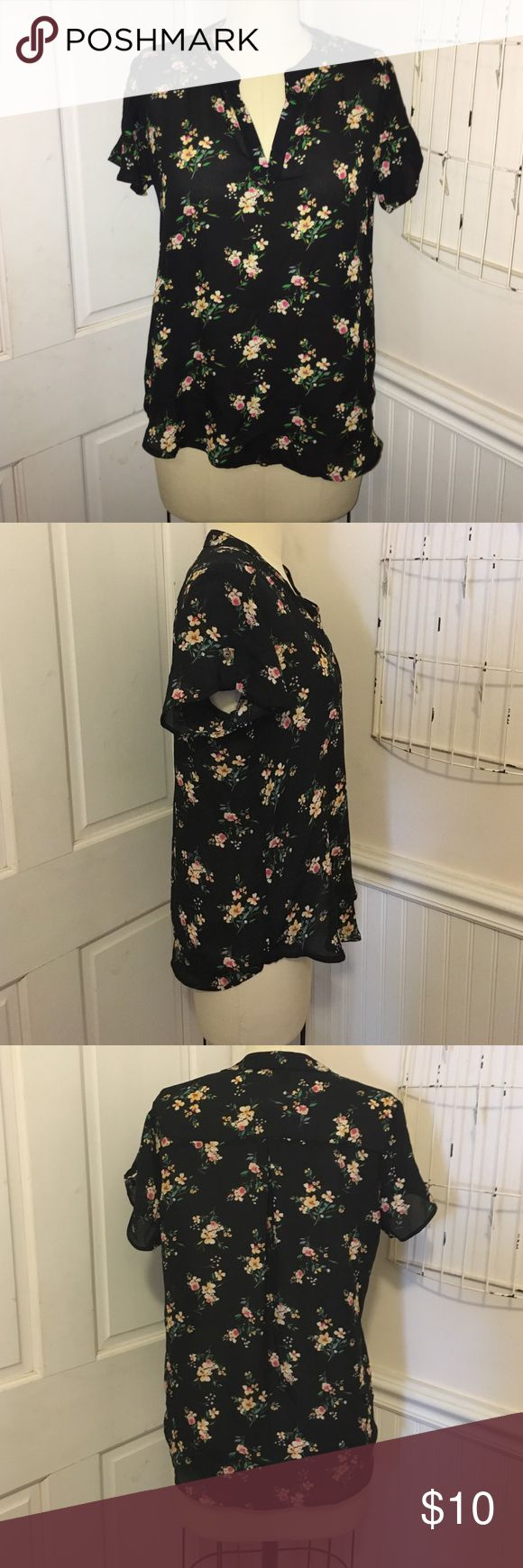 Floral short sleeve top size M This semi sheer top from forever 21 is a size M. Never worn with tags. 100% poly. Black grounded print with flowers. Forever 21 Tops Blouses