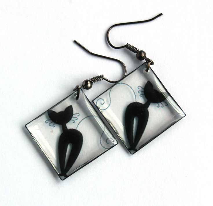 A personal favourite from my Etsy shop https://www.etsy.com/listing/238198755/handmade-cat-earrings-transparent
