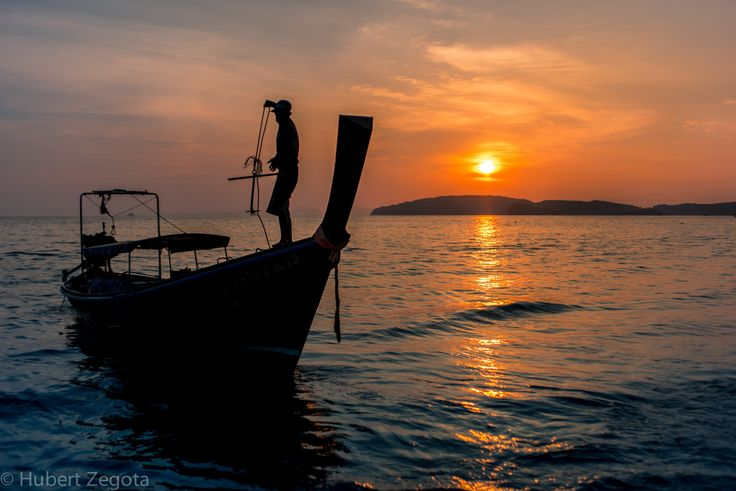 All aboad! - This one was taken during our vacations in Thailand. We went to a city beach for a sunset shooting. One of the longtail boats came to finish its work, and its captain was throwing anchor. We really enjoyed that moemnt.