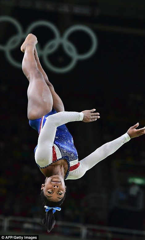 Simone Biles competes in the vault event of the women's individual all-around final of the...