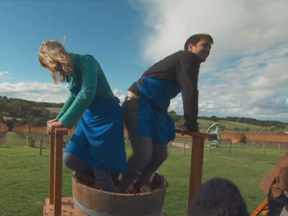 The contestants get hands on with some wine making.