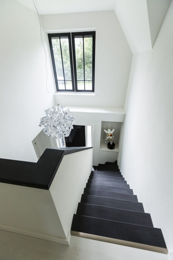 Landhuis bouwen trappenhuis modern vormgegeven