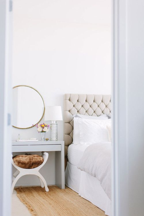 "Sneak Peek: A Chicago Apartment with a Sartorial Approach. ""In my bedroom I stuck to neutral tones with splashes of color. My bedding is a mix of pieces from Restoration Hardware and Pottery Barn. The tufted headboard was purchased at Antiques on Old Plank road. I love the relaxed feel of the bed and the mixed textures."" #sneakpeek"