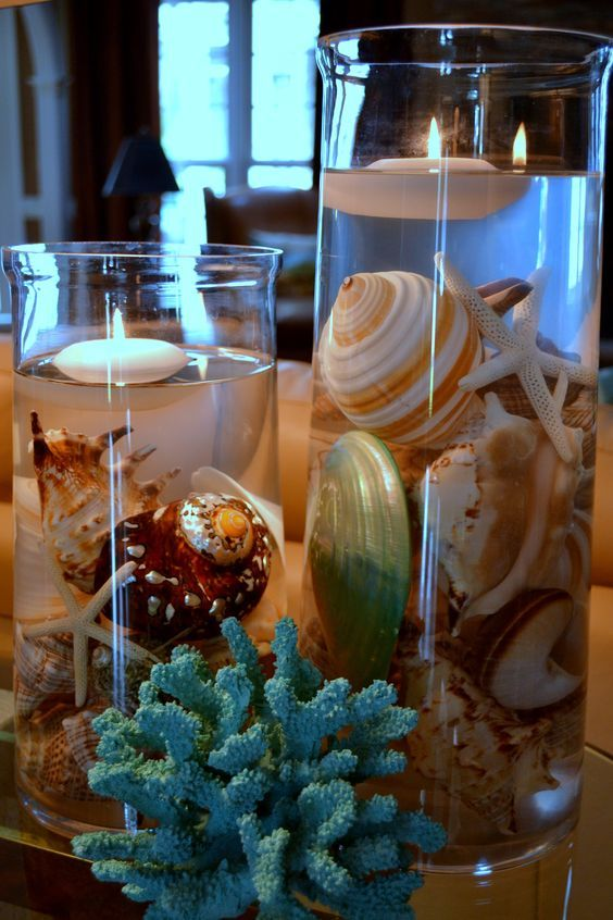 Center piece with beautiful shells, coral and floating candles for a beach theme: