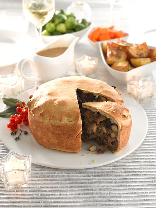 A hearty Christmas Pie filled with onions, leeks, mushrooms, cranberries, butter beans, chestnuts, hazelnuts and fresh thyme.