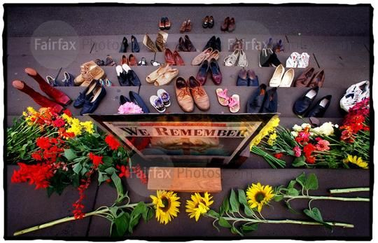 Thirty-six pairs of shoes representing those killed in the Port Arthur massacre in Tasmania in April 1996, sit beside flowers on the steps of Parliament House, commemorating the third anniversary of the tragedy, 28 April 1999. THE AGE Picture by SIMON O'DWYER