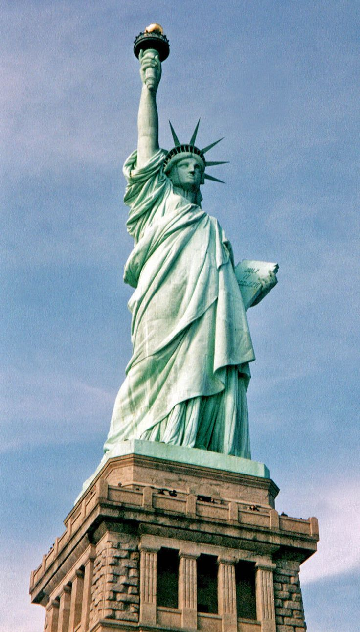 the statue of liberty The exterior copper covering of the statue of liberty is 3/32 of an inch thick (less than the thickness of two pennies) and the light green color (called a patina) is the result of natural weathering of the copper.
