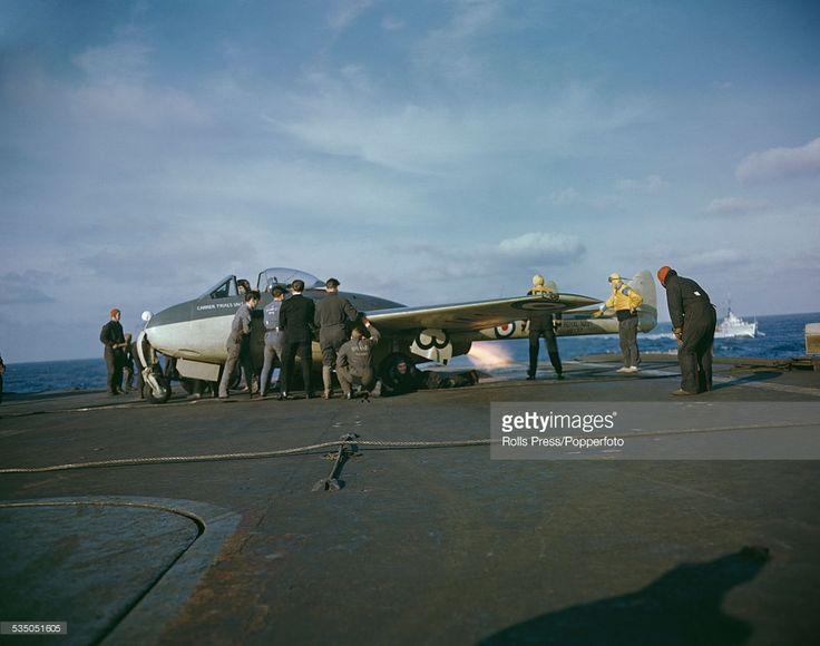 A Royal Navy de Havilland Sea Vampire jet aircraft undergoes testing on the flight deck of a Royal Navy aircraft carrier at sea during a training exercise circa 1950.