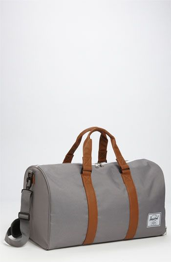 $80, Grey Canvas Duffle Bag: Novel Duffel Bag Grey Tan One Size by Herschel Supply Co.. Sold by Nordstrom. Click for more info: http://lookastic.com/men/shop_items/106494/redirect