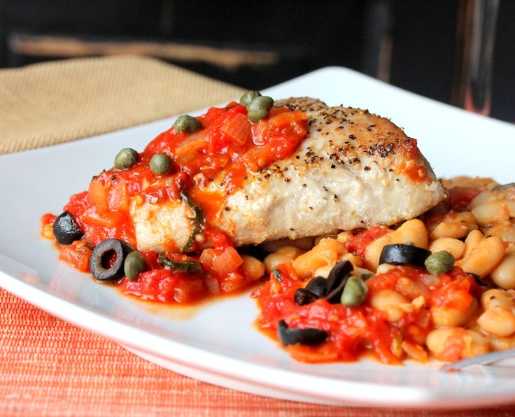 These Mediterranean Tuna Steaks marry together a wonderful Tuscan tomato and basil sauce with classic Mediterranean flavors such as olives, garlic & capers.