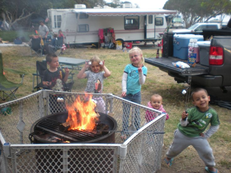 We have always brought a round baby gate to put around the campfire so our little ones don't run into the fire and get burned. We have the extendable roasting sticks so they can still reach the fire when the kids are roasting marshmallows. Plus you can rest your feet up on it when you're sitting around the fire at night. The best $64 we even spent for camping!