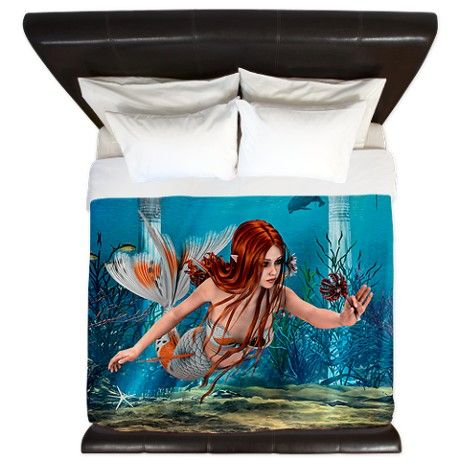 Mermaid holding Sea Lily King Duvet on CafePress.com