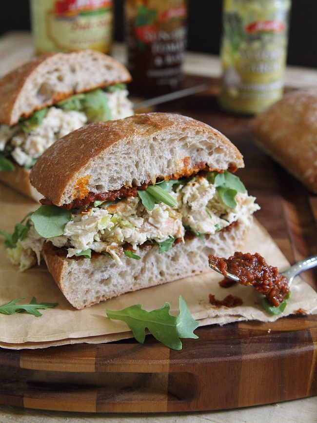Garlic yogurt chicken salad sandwich with sun dried tomato spread