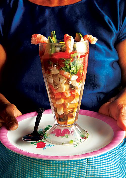 Cóctel de Mariscos (Seafood Cocktail) This zesty mix of fresh seafood, tomato and lime juices, and hot sauce is a refreshing snack or light meal eaten along Mexico's coasts.   | SAVEUR