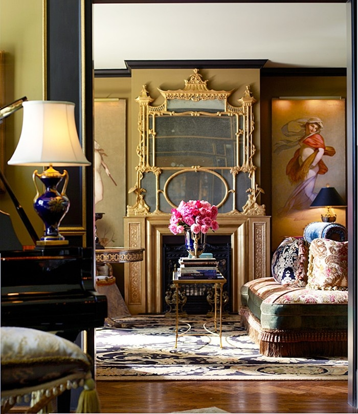 Baroque and asian. Olive and camel walls with dark gray trim. Gold and buillion fringe with expanses of olive, cream, and navy and highlights in pink and turquoise.