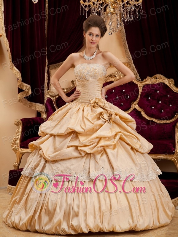 Beautiful Champagne Quinceanera Dress StraplessTaffeta Appliques Ball Gown  http://www.fashionos.com  http://www.facebook.com/quinceaneradress.fashionos.us  This graceful champagne quincenera gown accents a strapless bodice encrusted with beads on the bustline and a tight pleated waistline to create a flattering silhouette, your curves is clearly showed. The skirt features with ruffles , appliques and pleats give you a charming look.
