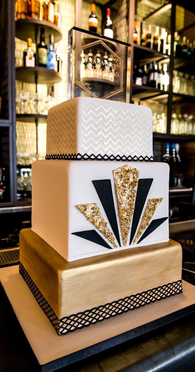 Art Deco Wedding Cake Black And Gold : Three-tiered gold and black Art Deco wedding cake The ...