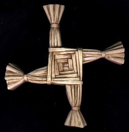 "St. Brigid's Cross  Legend says this cross was woven by the patron saint of Ireland to explain the Passion.  Its heritage extends to the Neolithic Age when it symbolized the four seasons. It is now hung over Irish doorways to protect home and hearth.  It is also related to the symbol of the ""turning wheel"" which symbolized the movement of the sun and is a design seen on Celtic crosses."