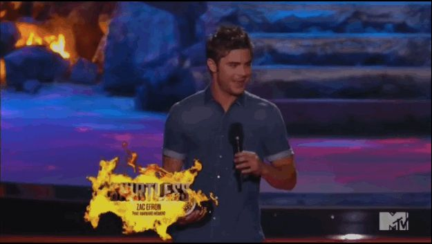 Zac won the award for Best Shirtless performance (obviously, there was NO competition). | The Only Thing You Need To See From The MTV Movie Awards Is Zac Efron's Shirt Getting Ripped Off