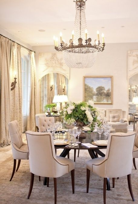 Love the living area combined with dining room, this room totally combines classic and modern pieces. LaMaisonware.com