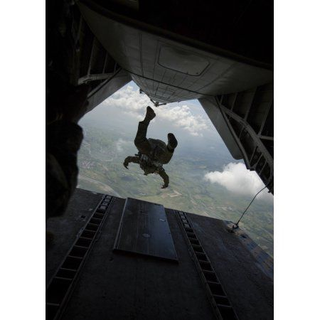 Philippine Army soldier jumps from a CH-53E Super Stallion Canvas Art - Stocktrek Images (24 x 33)