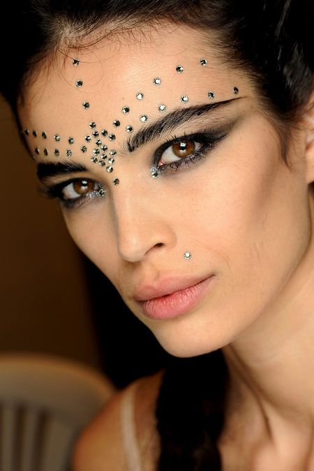 Indian-inspired face jewelry & kohl rimmed eyes at Jean Paul Gaultier Spring '13 Couture
