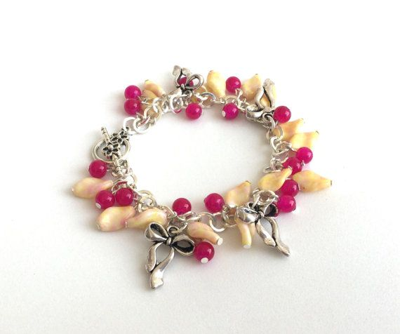 Charm bracelet bows with pink and yellow glass beads