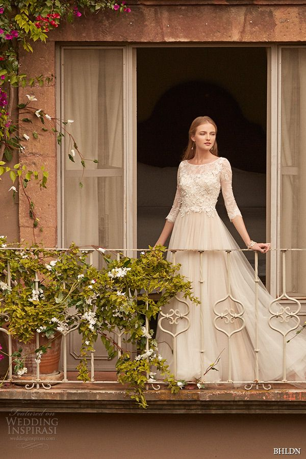 """Amelie, designed by Vatana Watters, features top-applied flowers on illusion tulle, sheer three-quarter sleeves, and a full, layered skirt."" BHLDN Spring 2015 Wedding Dresses — Campaign shoot 