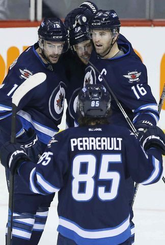 Winnipeg Jets' Drew Stafford (12), Bryan Little (18), Andrew Ladd (16) and Mathieu Perreault (85) celebrate Stafford's g...