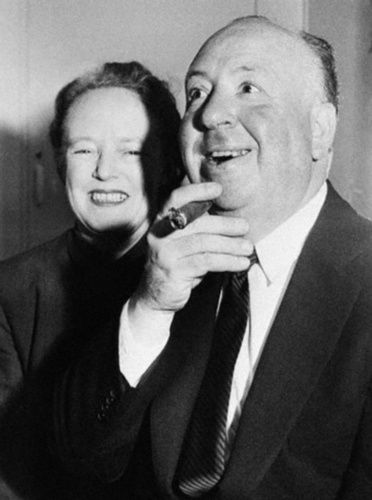 Photograph of Alma Reville and Alfred Hitchcock, taken aboard the Cunard Line's RMS Queen Elizabeth which had just docked at Southampton from New York. The couple were embarking on a research trip for Flamingo Feather.
