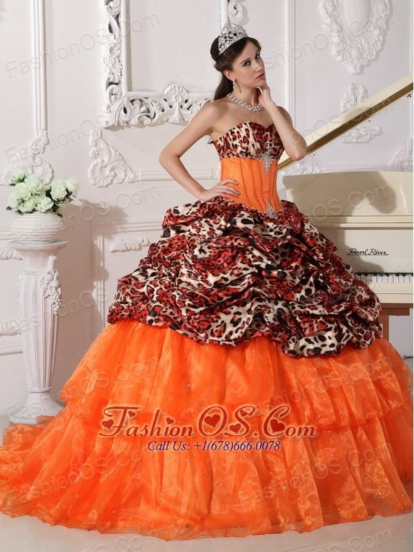 Sweetheart Sweep / Brush Train Leopard and Organza Appliques Ball Gown  http://www.fashionos.com  http://www.facebook.com/quinceaneradress.fashionos.us  This sparkling quinceanera ball gown with a strapless sweetheart neckline,fitted bodice with clear beading trims the bust and waist.This dress creates combines a leopard print bust and top skirt with pick ups with a layered tulle skirt.What a show stopper!