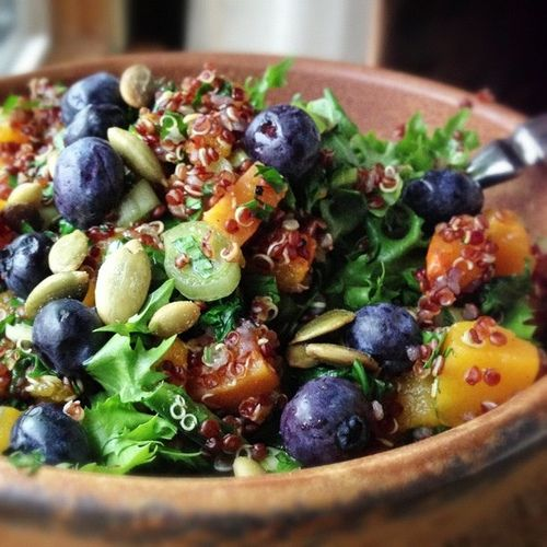 Quinoa or bulgur wheat with blueberries, mangos, spring onion, basil, mint, toasted pumpkin seeds, lemon juice and olive oil