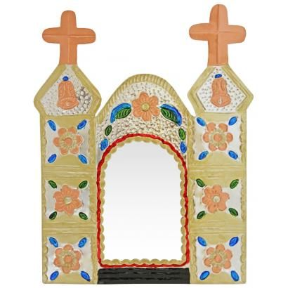 Mexico has long been known for its colorful and uniquely original tin mirror frames, and this darling Cathedral Mirror proves precisely why.  Hand-punched and hand-painted in Oaxaca, Mexico, its bold colors will revitalize even the drabbest of walls.  It's the perfect way to embrace your own Mexican or Southwestern spirit, and to bring out the interior decorator in all of us!  Also makes a striking yet inexpensive gift that will be cherished for years.