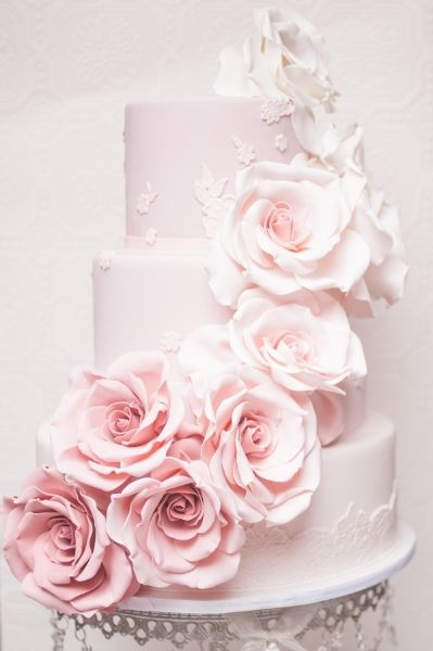 Stunning pastel pink wedding cake with cascading ombre roses