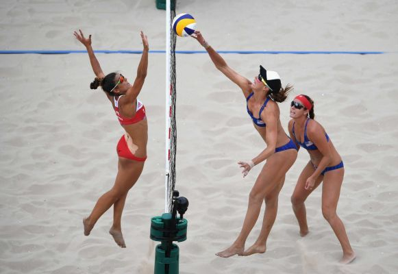 Kinga Kolosinska of Poland in action against Lauren Fendrick and Brooke Sweat of the United States during the Women's Beach Volleyball preliminary round Pool A match on Day 2 of the Rio 2016 Olympic Games at the Beach Volleyball Arena on August 7, 2016 in Rio de Janeiro, Brazil.