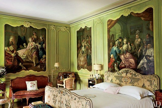 At Marella Agnelli's estate in Northern Italy, decorated by Stephane Boudin in the 1950s, the Bishop's Room features antique paintings set within carved moldings | archdigest.com