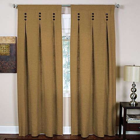 These stylish, solid-colored window panels add a decorative touch with three wooden buttons at the top of each panel. The panels also feature inverted pleats and have a warm, inviting feel.