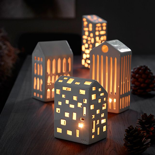 The glimmering light and the shadows casted from the tea lights inside the beautiful Urbania candle houses, remind us of the unique atmosphere and comfort of our homes.